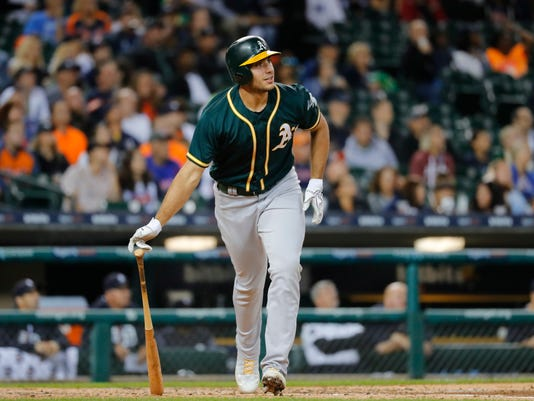Oakland Athletics' Matt Olson watches his solo home run against the Detroit Tigers in the third inning of a baseball game in Detroit, Monday, Sept. 18, 2017. (AP Photo/Paul Sancya)