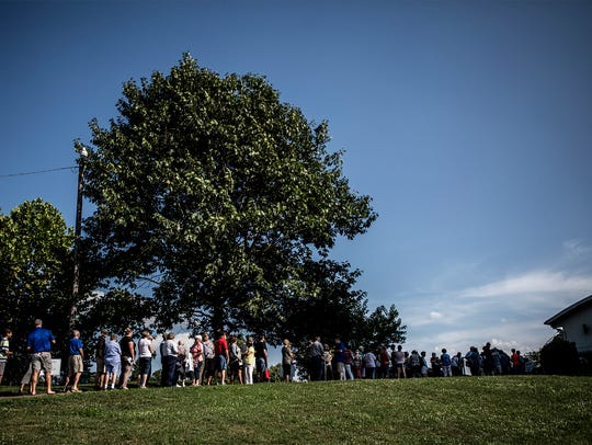 A line forma at Coshocton Lake Park before the doors