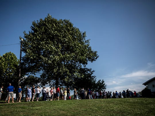 A line forma at Coshocton Lake Park before the doors open for the 14th annual; Taste of Coshocton event.