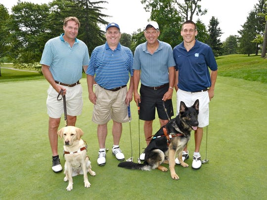 Guiding Eyes for the Blind's Sponsor of the Year John DeVito of Katonah, owner of A. DeVito & Son, will be honored at the 37th annual Guiding Eyes Golf Classic on June 9. Pictured are DeVito, second from right, with son, Kyle, to his left, at last year's Golf Classic. Also pictured are James Donohue, far left, and John Feeney, far right.