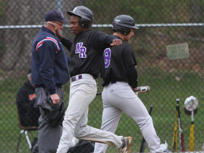 New Rochelle's JoJo Gray scores on a double by Nick Teto during their baseball game against White Plains at White Plains High School, April 29, 2014. New Rochelle beat White Plains, 5-1.