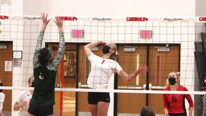 Coldwater's Allison Miller skies for a kill versus Pennfield Wednesday while teammate Maddie Beckhusen (6) looks on.