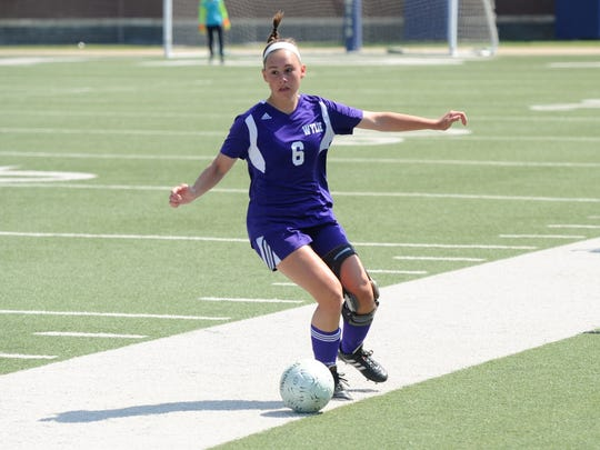 Wylie's Tatum McClellan (6) looks to make a play during