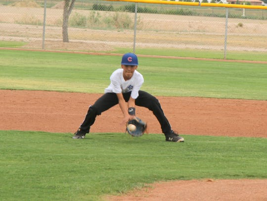 Jeremyah Dominguez fields a ground ball at shortstop
