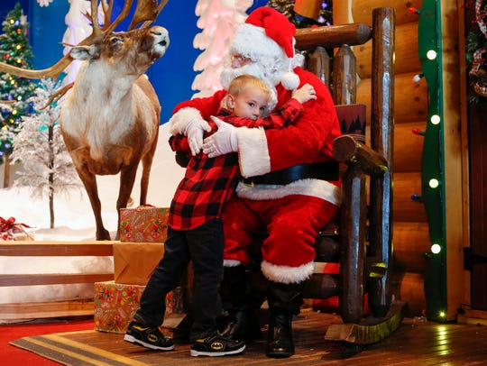 Luke Dewing, 4, of Springfield, hugs Santa at Bass
