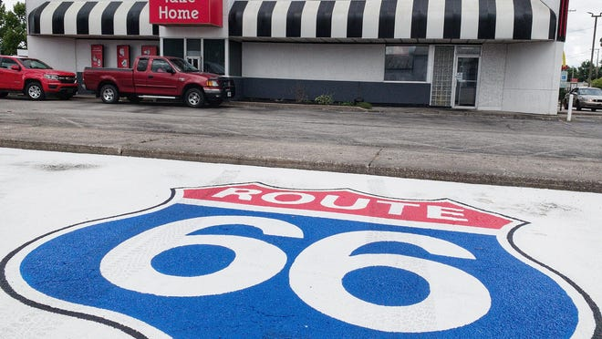 A Route 66 logo is painted on the parking lot at Steak 'n Shake, 1066 N. Henderson St. The fast food chain announced Tuesday it will revive its car-hop drive-in service at restaurants across the U.S., including the Galesburg location.