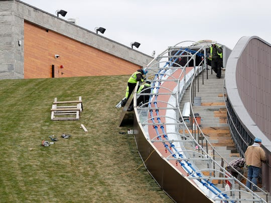Workers construct the side barrier on the sledding hill in the Titletown District on Tuesday, November 21, 2017 in Ashwaubenon, Wis.