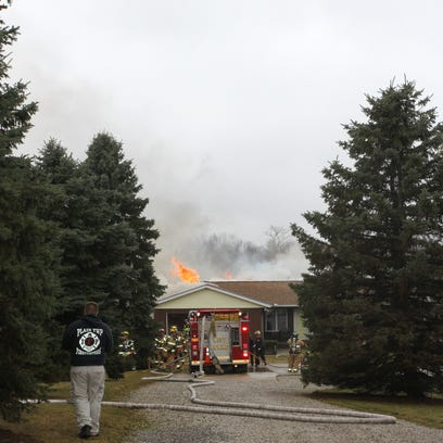 Flames leap from the roof of a Gale Road home.