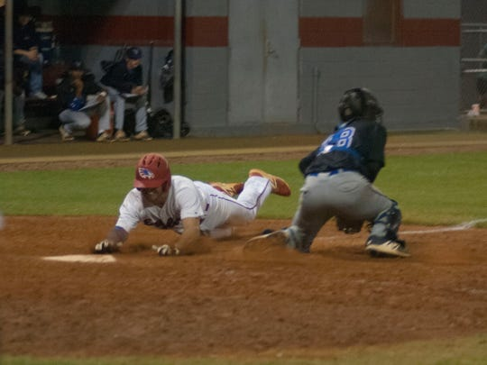Pine Forest's Thomas DeFranco slides in safely to score