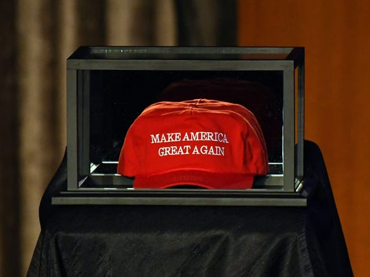 Nov 8, 2016; New York, NY, USA;   A Make America Great Again hat is placed on the side of the stage prior to Republican Party candidate Donald Trump speaking to supporters at New York Hilton Midtown on election night.  Mandatory Credit: Robert Deutsch-USA TODAY NETWORK ORG XMIT: USATSI-353736 ORIG FILE ID:  20161108_ajw_usa_092.jpg