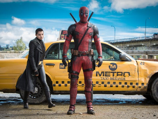 Deadpool (Ryan Reynolds, right) readies for confrontation,