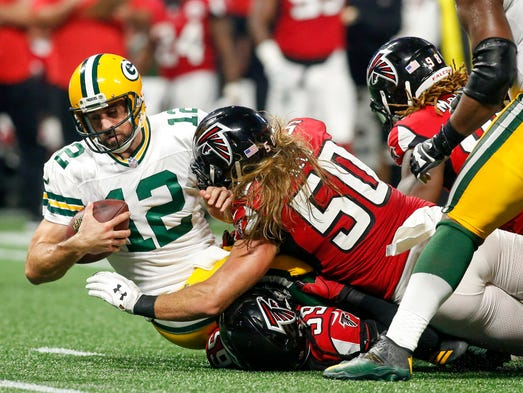Green Bay Packers quarterback Aaron Rodgers (12) is