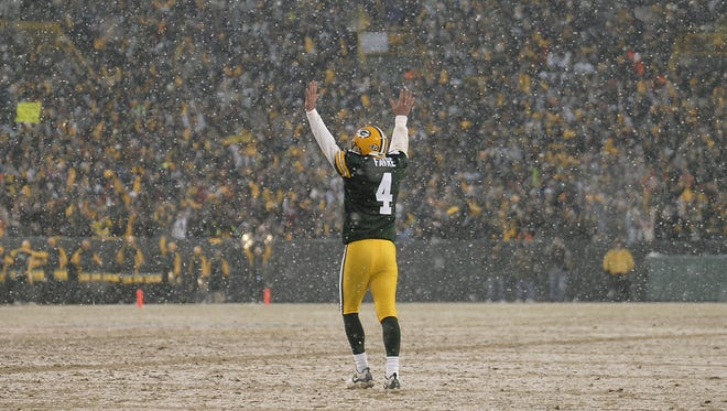 Green Bay Packers quarterback Brett Favre celebrates after a touchdown during the 2008 playoff game against the Seattle Seahawks.