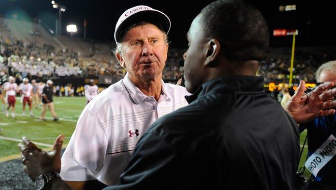 South Carolina coach Steve Spurrier and Vanderbilt coach Derek Mason shake hands after the Gamecocks' 48-34 win last season. Spurrier resigned on Monday.
