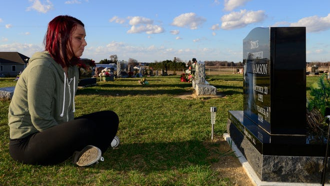 Brittany Hatfield, 23, of Clyde visits the grave of her ex-boyfriend, Bryce Williamson, whom she loved deeply. He died of a heroin overdose in November 2014.