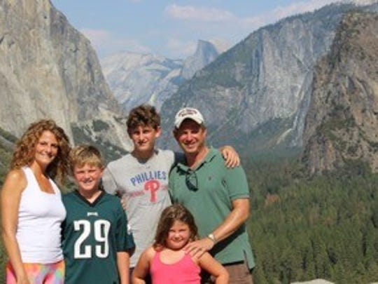 Joanna and Jon Kleinman enjoy a vacation with their kids. Shared family experiences can bring siblings closer.