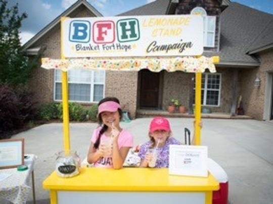 Olivia Myrick, right, hosts a Blanket Fort Hope lemonade stand to raise money for the organization that brings awareness to human trafficking. Her campaign raised $800 and she is challenging the community to match her efforts.