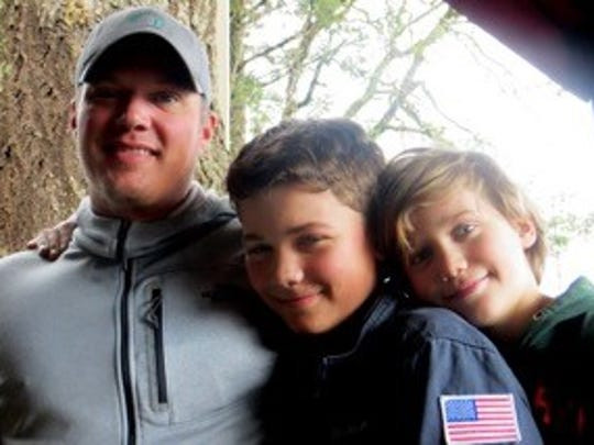 Togni poses with his kids in Oregon.