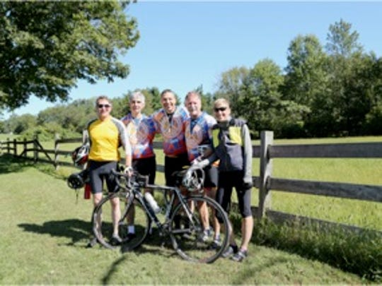 Riders take a break at a rest stop at the Hillsborough