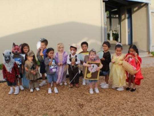 Pre-K3 students posing for a picture after the parade
