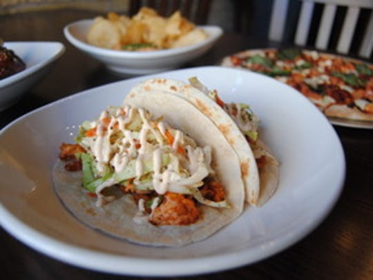 Tacos and pizzas are some of the menu items at Oak