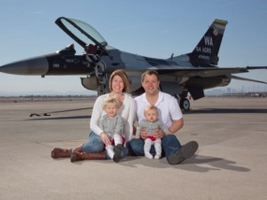 Laura Neary and Eric Flattern pose with their children.
