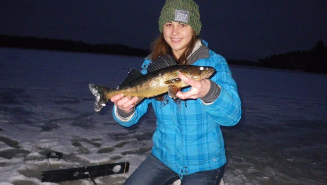 """Beth Sommerfeldt with a 17"""" inchwalleye caught & released from a Price County water."""