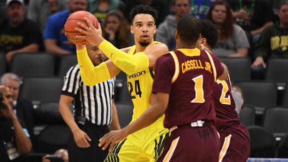 Mar 17, 2017; Sacramento, CA, USA; Oregon Ducks forward Dillon Brooks (24) controls the ball as Iona Gaels guard E.J. Crawford (2) and Gaels guard Sam Cassell Jr. (1) defend during the first half in the first round of the 2017 NCAA Tournament at Golden 1 Center. Mandatory Credit: Kyle Terada-USA TODAY Sports