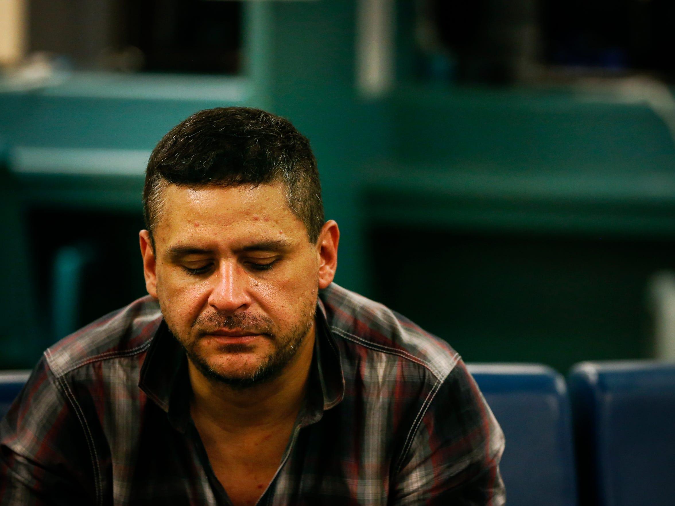 41-year-old John Palao waits in Metro Corrections booking