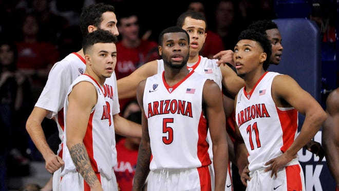 Dec 19, 2015: Arizona Wildcats guard Gabe York (left) and guard Kadeem Allen (5) and forward Ryan Anderson (back, right) and guard Allonzo Trier (11) look to the bench during the second half against the UNLV Rebels at McKale Center. Arizona won 82-70.
