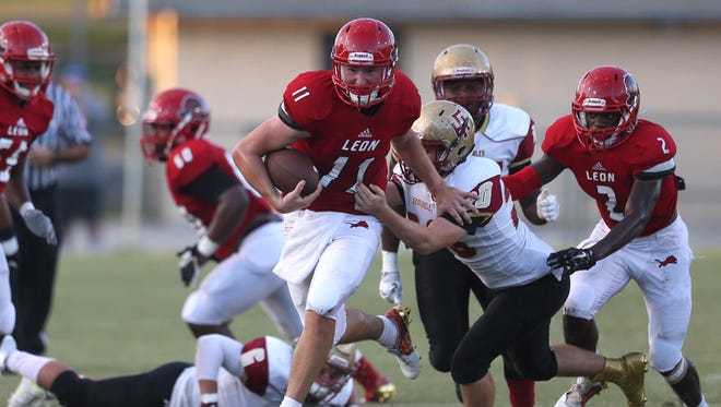Leon's John Carey runs against Florida High at Cox Stadium on Thursday. Carey ran for two touchdowns in a 23-10 win.