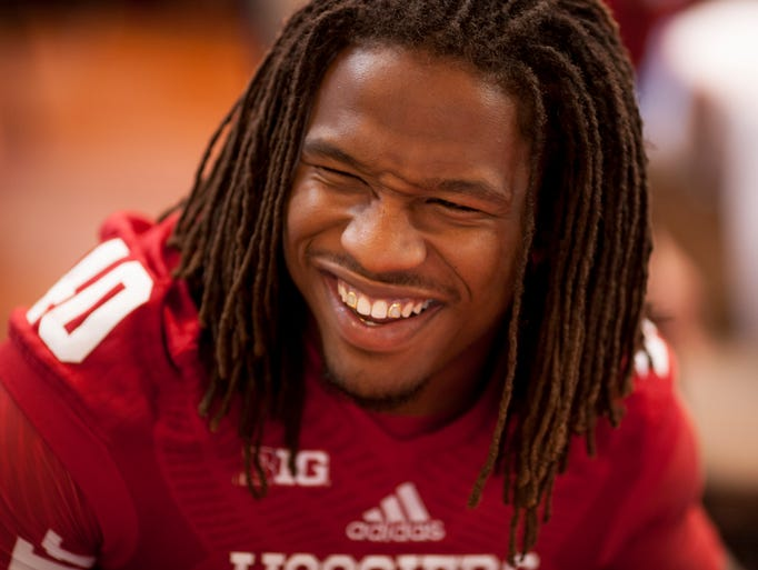 Indiana safety Antonio Allen shares a laugh as he speaks with reporters during the Indiana University football media day on Monday, Aug. 4, 2014, at Memorial Stadium in Bloomington.