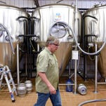 Beaver Island Brewing Co. brewmaster Chris Laumb talks Tuesday, June 7, in St. Cloud about his experiences during a recent tour of breweries in Germany.