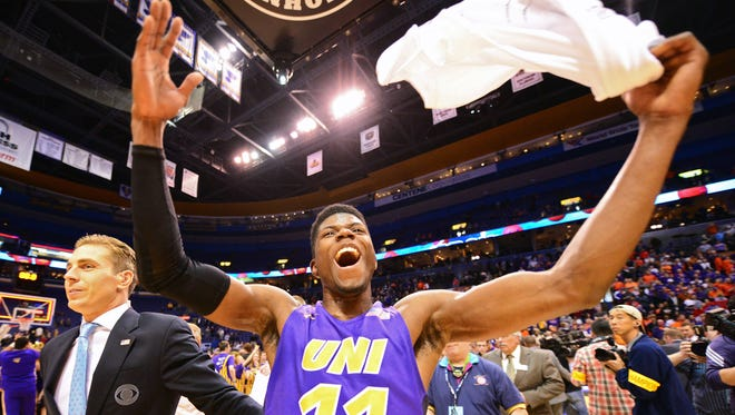 Northern Iowa Panthers guard Wes Washpun (11) celebrates after hitting the game winning shot at the buzzer to defeat the Evansville Aces in the championship game of the Missouri Valley Conference tournament at Scottrade Center. Northern Iowa defeated Evansville 56-54 and will play Texas in the first round Friday.