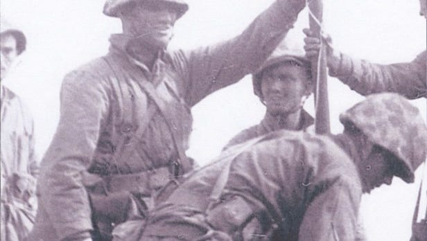 This photo, also first discovered in 2002, shows Appleton's John Bradley clutching the first flag that was raised at Iwo Jima.