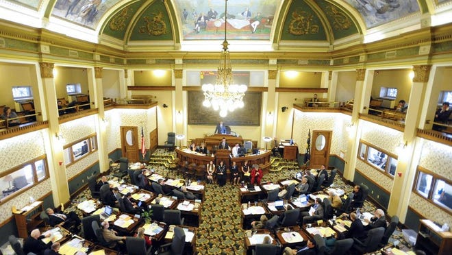 Legislators convene in the Montana state Capitol.