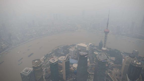 A general view shows the skyline of the Lujiazui Financial District in Pudong, seen from the 109th floor of the Shanghai Tower (still under construction), covered in smog in Shanghai on October 16, 2014. (Johannes Eisele, AFP Getty Images)