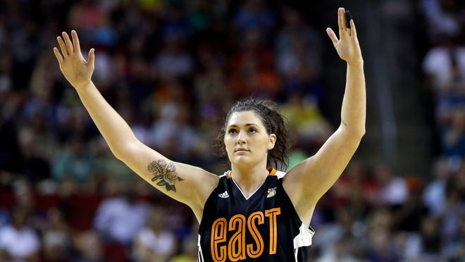 From July 22, 2017, Chicago Sky's Stefanie Dolson raises her hands in the second half of the WNBA All-Star basketball game in Seattle.  Dolson says she tested positive for the cororavirus. She is the first known Chicago professional athlete and the second WNBA player known to have contracted COVID-19. Dolson announced that she caught the virus in a video that aired Friday, April 17, 2020 during ESPN's broadcast of the WNBA draft.
