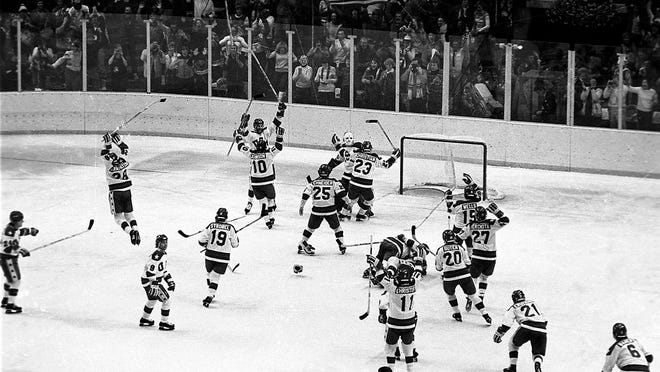 From Feb. 22, 1980, the U.S. ice hockey team rushes toward goalie Jim Craig after their 4-3 upset win over the Soviet Union in a medal round match at the Winter Olympics in Lake Placid, N.Y. Some of the U.S. players shown are Mark Johnson (10); Eric Strobel (19); William Schneider (25); David Christian (23); Mark Wells (15); Steve Cristoff (11); Bob Suter (20) and  Philip Verchota (27).
