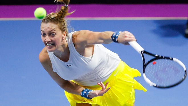 Petra Kvitova of Czech Republic returns the ball to Alison van Uytvanck of Belgium during the St. Petersburg Ladies Trophy-2020 tennis tournament match in St.Petersburg, Russia, Thursday, Feb. 13, 2020.