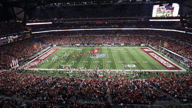 Ohio State takes the field for their game against Wisconsin in the 2019 Big Ten Championship game at Lucas Oil Stadium.