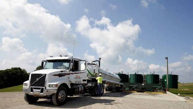 A truck unloads in fracking wastewater at an injection well near Cambridge in eastern Ohio.