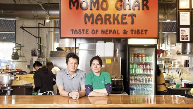Phuntso Lama (right) and her husband, Pramod, photographed at Momo Ghar in the North Market. The couple are opening a full-scale restaurant in Dublin.