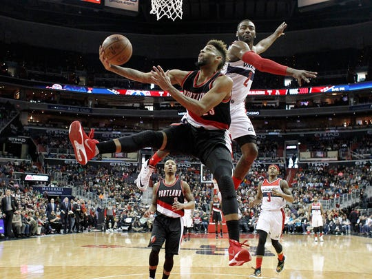 Portland Trail Blazers guard Allen Crabbe (23) shoots in front of Washington Wizards guard John Wall (2) in the second half of an NBA basketball game, Monday, Jan. 18, 2016, in Washington. The Trail Blazers won 108-98.