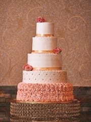 This multitiered quinceanera cake includes a sparkling