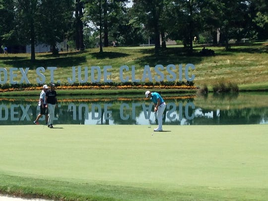 Sam Burns hits a putt during Thursday's first round of the FedEx St. Jude Classic in Memphis. Burns shot a 2-over 72.