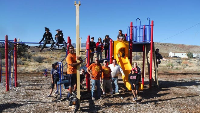 Red Rock Rotary members volunteer at the playgorund on the Shivwits reservation.