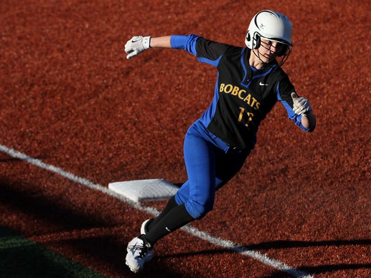 Bloomfield's Ashley Lewellen turns the corner at third base during Saturday's game against San Juan, Utah, at the Bloomfield Softball Complex.
