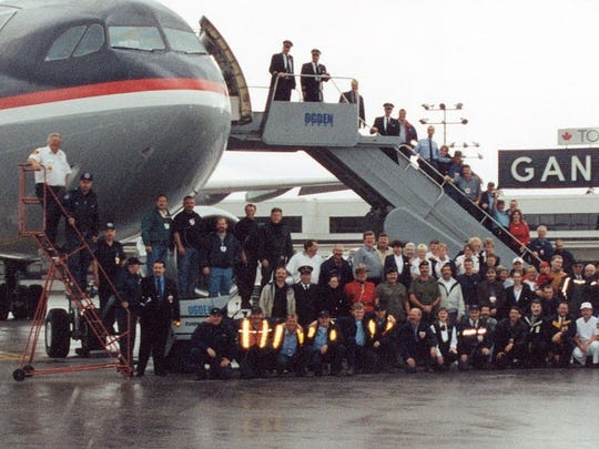 This Sept. 15, 2001 photo provided by Des Dillon shows the last flight to leave the town after the passengers were stranded there for five days following the Sept. 11, 2001 terrorists attacks. Dillon, a Gander, Newfoundland, Canada resident headed up the emergency response for the Red Cross in Gander.