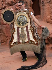 """Jim J. Bullock plays Cogsworth during a rehearsal of Disney's """"Beauty and the Beast"""" Wednesday evening at Tuacahn Amphitheatre in Ivins City."""
